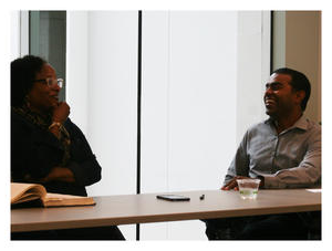 Professor Thomas M. Philip and MFEI Executive Director Alicia Dixon discuss the challenges of equity 和 inclusion in public schools. On the table is Dr. Marcus A. Foster's thesis, which is on loan from the University of Pennsylvania.